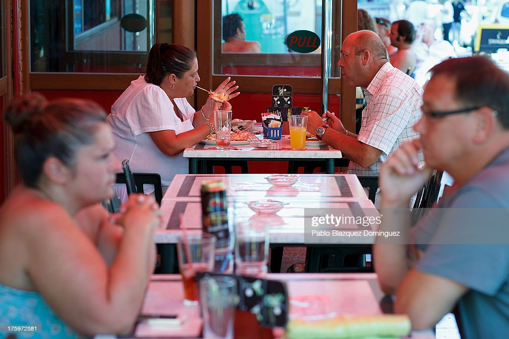 People have a meal at a British restaurant on August 10, 2013 in Benidorm, Spain. Benidorm is one of Europe's top package holiday destinations and one of Spain's busiest tourist destinations. The Costa Blanca hotspot of Benidorm is calculated to have a population of around 72,000, which is estimated to rise to more than 300,000, during the summer months as the tourists and visitors flock to its popular beaches.