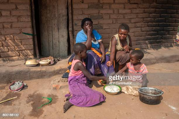 People have lunch in Kamkwamba village in Kasungu on June 22 during a presentation for the UNICEFfunded Humanitarian Drone Corridor testing project...