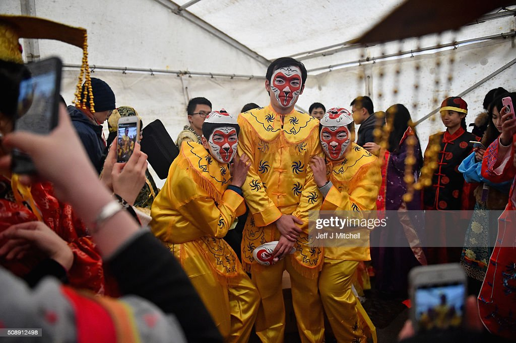 People have their photo taken as the Chinese community of Glasgow are dressed in traditional costumes celebrate The Year of The Monkey on February 7, 2016 in Glasgow, Scotland. The first ever Chinese New Year celebrations to be held in George Square, The Year of the Monkey begins on February 8th and lasts until January 27, 2017.