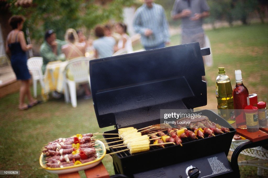 people having barbecue stock photo getty images. Black Bedroom Furniture Sets. Home Design Ideas