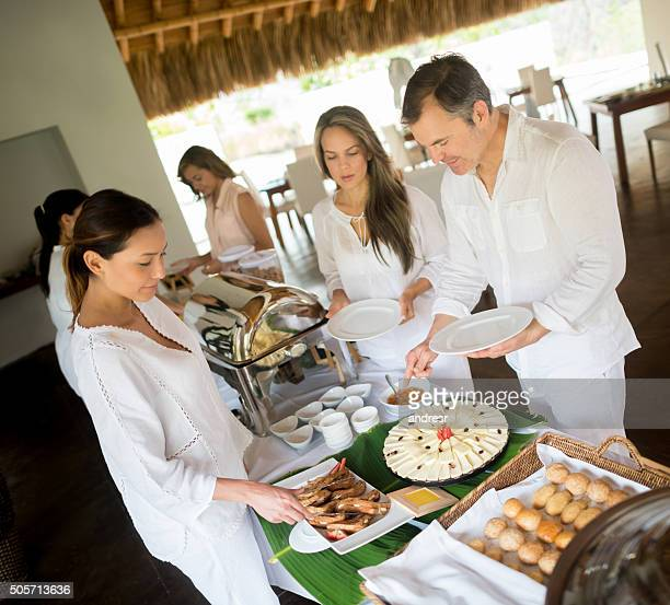 People having breakfast at a hotel's buffet