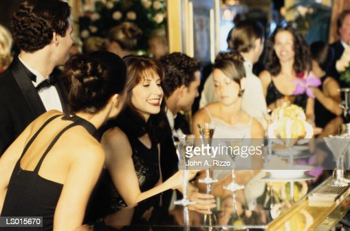 People having cocktails at bar : Stock Photo