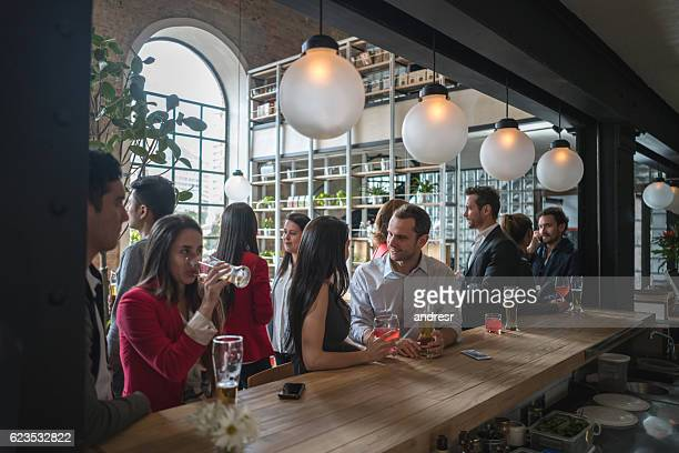 People having drinks at a bar