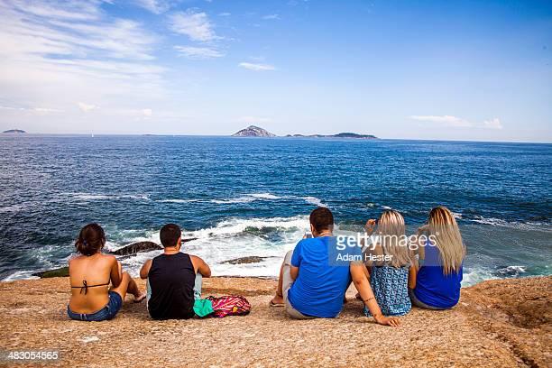People having fun and relaxing on Ipanema Beach.
