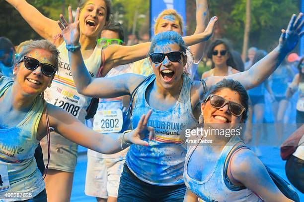 People having fun in the celebration of the powder colorful Color Run by Desigual in Barcelona May 18th of 2014