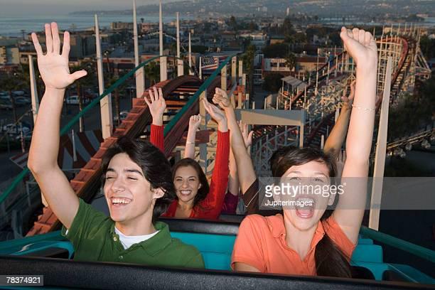 People having fun on roller coaster