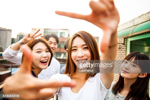 People having fun, taking a Selfie all together at party