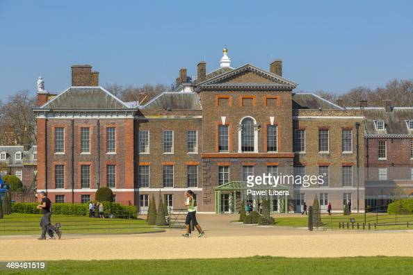 People having morning stroll in Kensington Gardens in the front of Kensington Palace in London