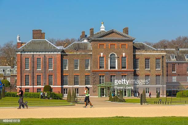 People having morning stroll in Kensington Gardens in the front of Kensington Palace in London