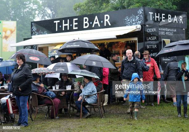 People head for the refreshment areas as heavy rains falls during the Bramham International Horse Trials at Bramham Park West Yorkshire