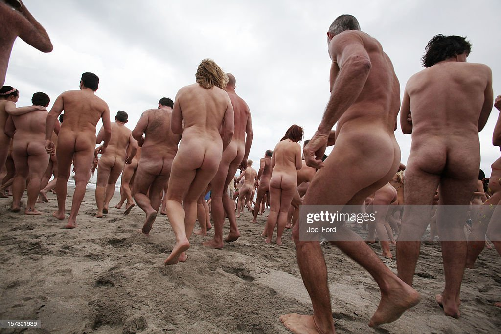People head for the water during an attempt to break the skinny dip world record at Papamoa Beach on December 2, 2012 in Tauranga, New Zealand.