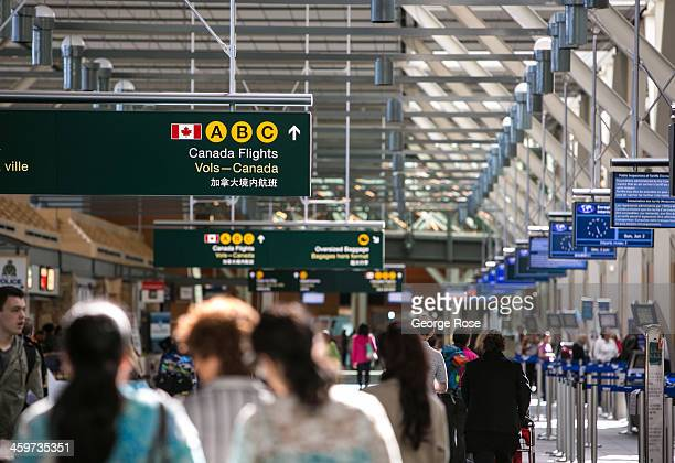 People head to their flights in the Vancouver International Airport terminal on June 2 2013 in Vancouver British Columbia Canada Vancouver a seaport...