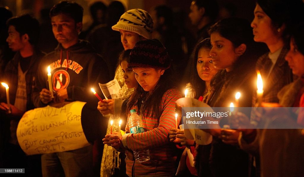 People held Candle Light silent March during the protest at Jantar Mantar to mourn for girl who died of injuries after brutally gang raped in a moving bus on December 30, 2012 in New Delhi, India. The young woman was cremated promptly on Sunday amid an outpouring of anger and grief by millions across the country demanding greater protection for women from sexual violence.