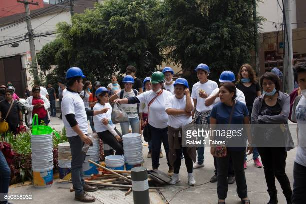 People help distribute supplies at Parque Mexico in the Condesa district the day after an earthquake on September 20 2017 in Mexico City Mexico...