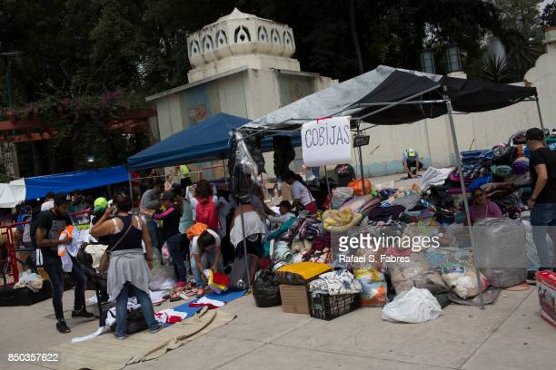 People help distribute supplies including blankets at Parque Mexico in the Condesa district the day after an earthquake on September 20 2017 in...