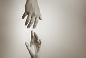 Hand reaching out to help another.