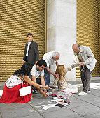 People helping woman fallen on street