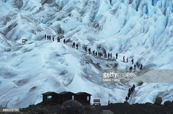 People hike on the Perito Moreno glacier in Los Glaciares National Park part of the Southern Patagonian Ice Field on November 30 2015 in Santa Cruz...