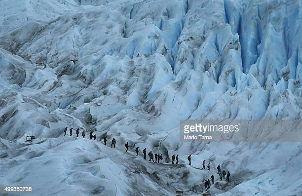 People hike on the Perito Moreno glacier in Los Glaciares National Park part of the Southern Patagonian Ice Field on November 30 2015 in Santa Cruz...