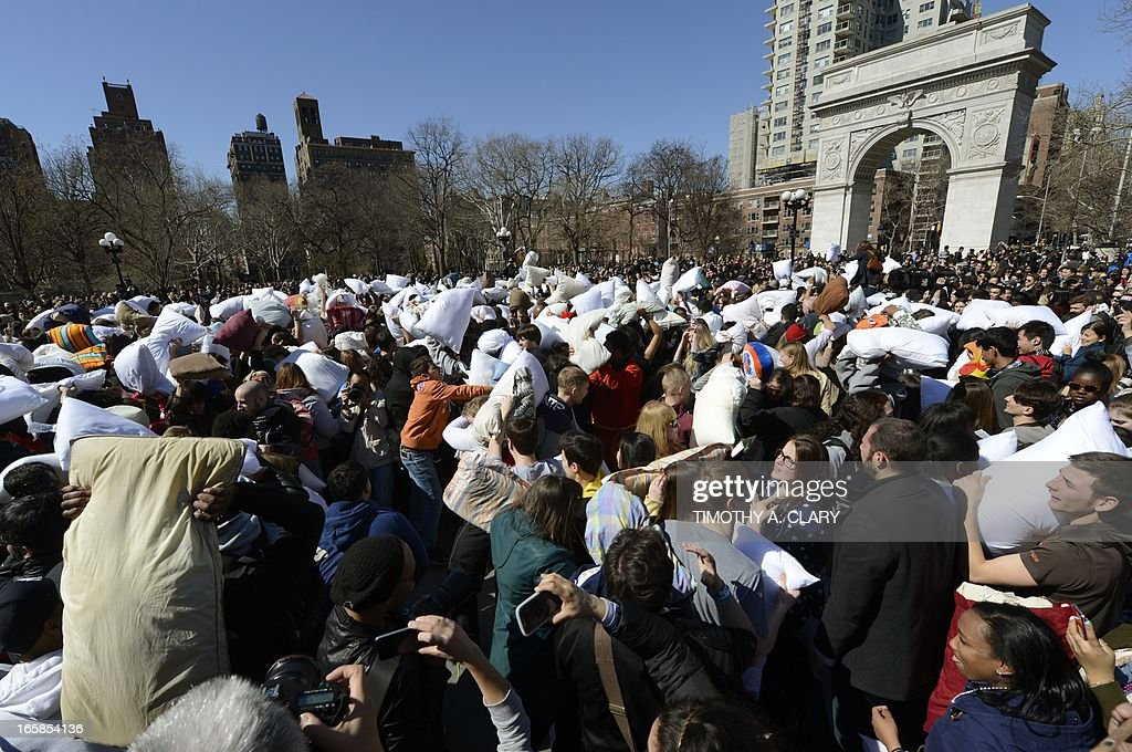 People hit each other with pillows as they take part in the world's 6th annual Pillow Fight Day in Washington Square Park in New York on April 6, 2013. The massive pillow fight, which is the New York City's 8th annual, takes place in cities around the world. AFP PHOTO/TIMOTHY A. CLARY