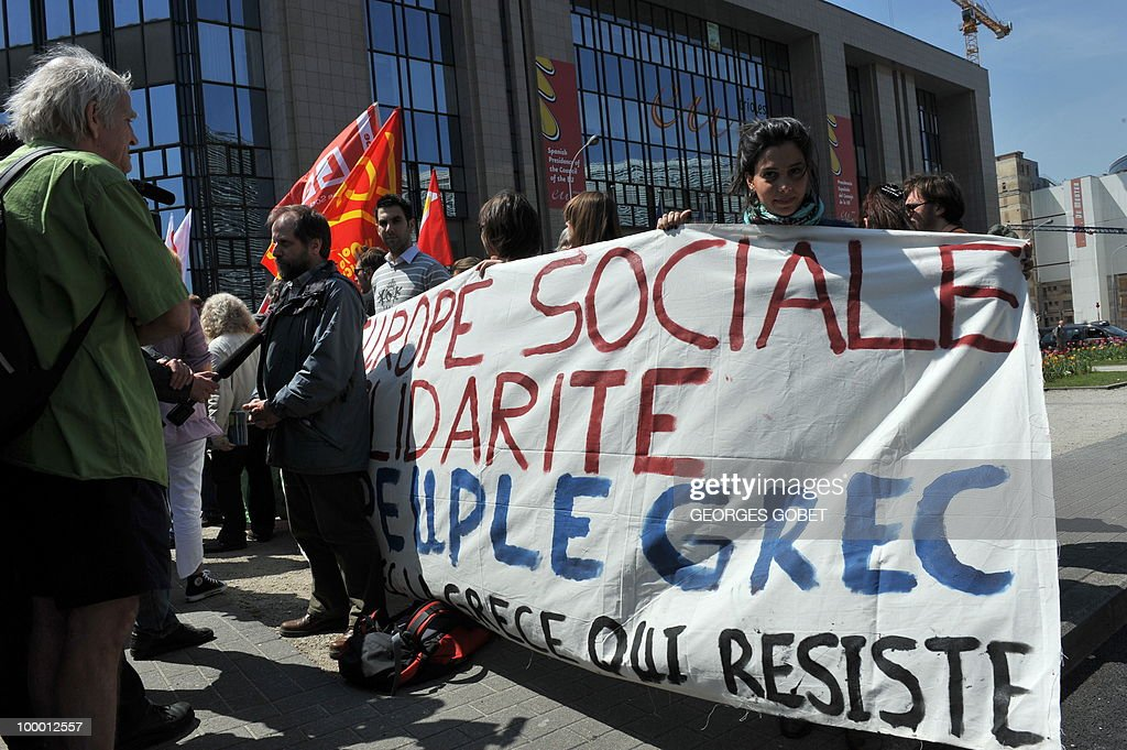 People hold a banner asking for a 'Social Europe' during a demonstration in solidarity with the Greek workers in front of the EU Commission building on May 20, 2010 in Brussels. Meanwhile, more than 20,000 Greeks took to the streets of Athens and second city Thessaloniki on Thursday in a new general strike against the government's debt-dictated austerity spending cuts and pension reform.