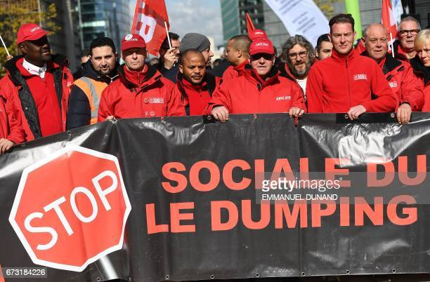 People hold a banner during a demonstration of European transport union activists against social dumping in front of the European institutions in...