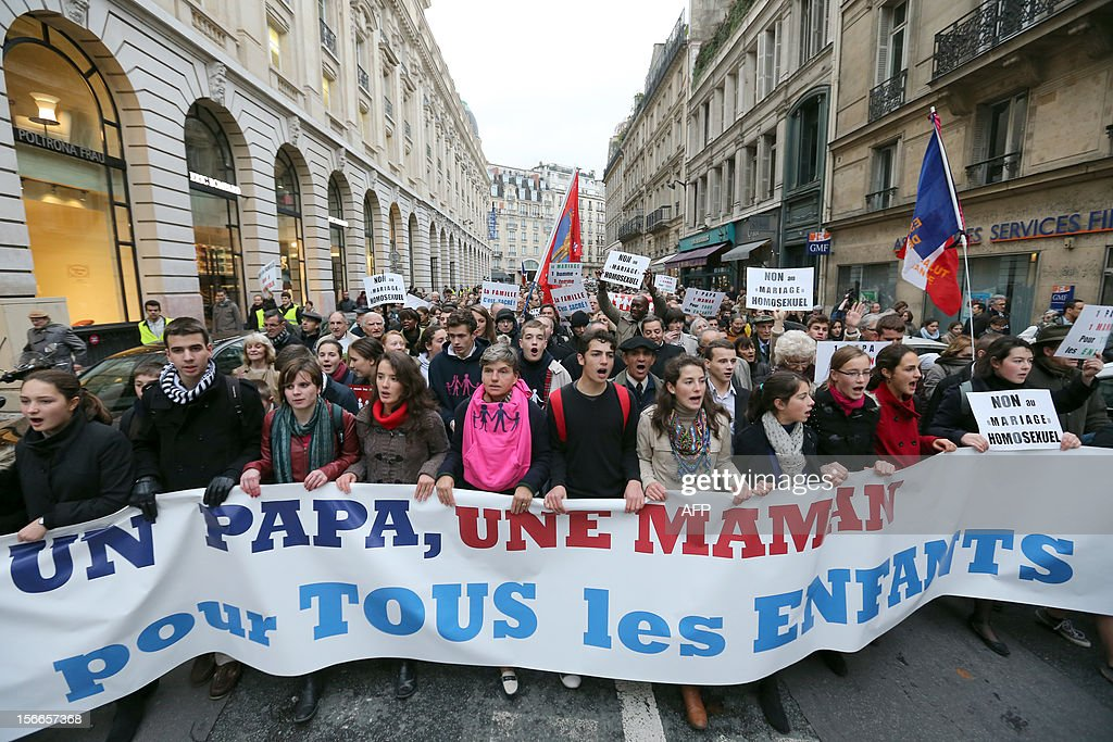 People hold a banner during a protest organized by fundamentalist Christians group Civitas Institute against the same-sex marriage on November 18, 2012 in Paris. France's Socialist government on November 7, 2012 adopted a draft law to authorise gay marriage and adoption despite fierce opposition from the Roman Catholic Church and the right-wing opposition.