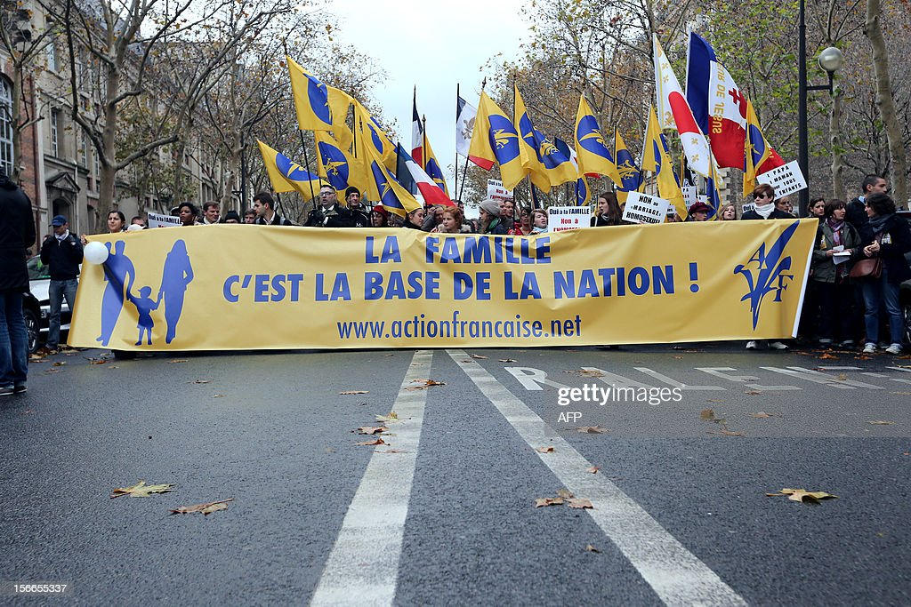 People hold a banner reading 'family is the foundation of the nation' during a protest organized by fundamentalist Christians group Civitas Institute against the same-sex marriage on November 18, 2012 in Paris. France's Socialist government on November 7, 2012 adopted a draft law to authorise gay marriage and adoption despite fierce opposition from the Roman Catholic Church and the right-wing opposition.