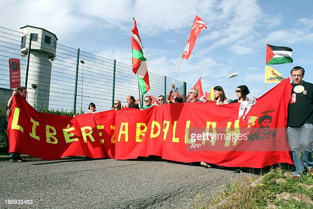 People hold a banner reading 'Free Abdallah' as they take part in a protest calling for the liberation of Lebanese activist Georges Ibrahim Abdallah...