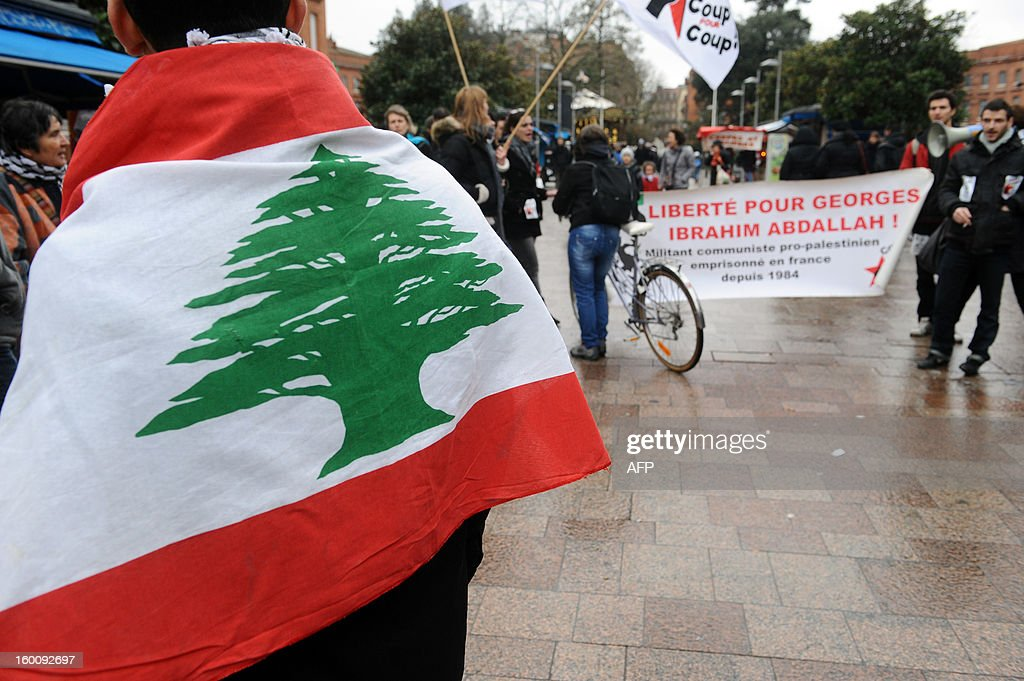 People hold a banner reading 'Freedom for Georges Ibrahim Abdallh', a pro-palestinian militant, during a protest in Toulouse, southwestern France, on January 26, 2013. French ambassador to Lebanon Patrice Paoli promised on January 15, 2013 to convey to his government concerns aired by the Lebanese authorities over the delayed release of a militant granted parole. A French court granted Georges Ibrahim Abdallah, 61, parole in November on condition he be deported but a judicial source said on Monday the interior ministry had yet to issue the deportation order. The court postponed its decision on his release until January 28. .AFP PHOTO/REMY GABALDA