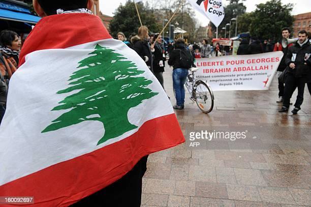 People hold a banner reading 'Freedom for Georges Ibrahim Abdallh' a propalestinian militant during a protest in Toulouse southwestern France on...