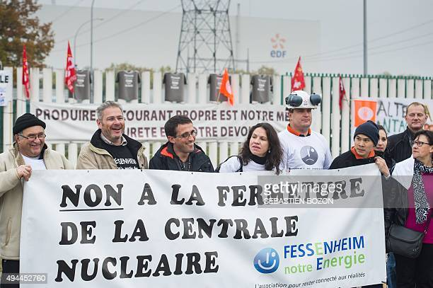 People hold a banner reading 'No to the nuclear powerplant closure' during a demonstration on October 27 in front of the nuclear powerplant of...
