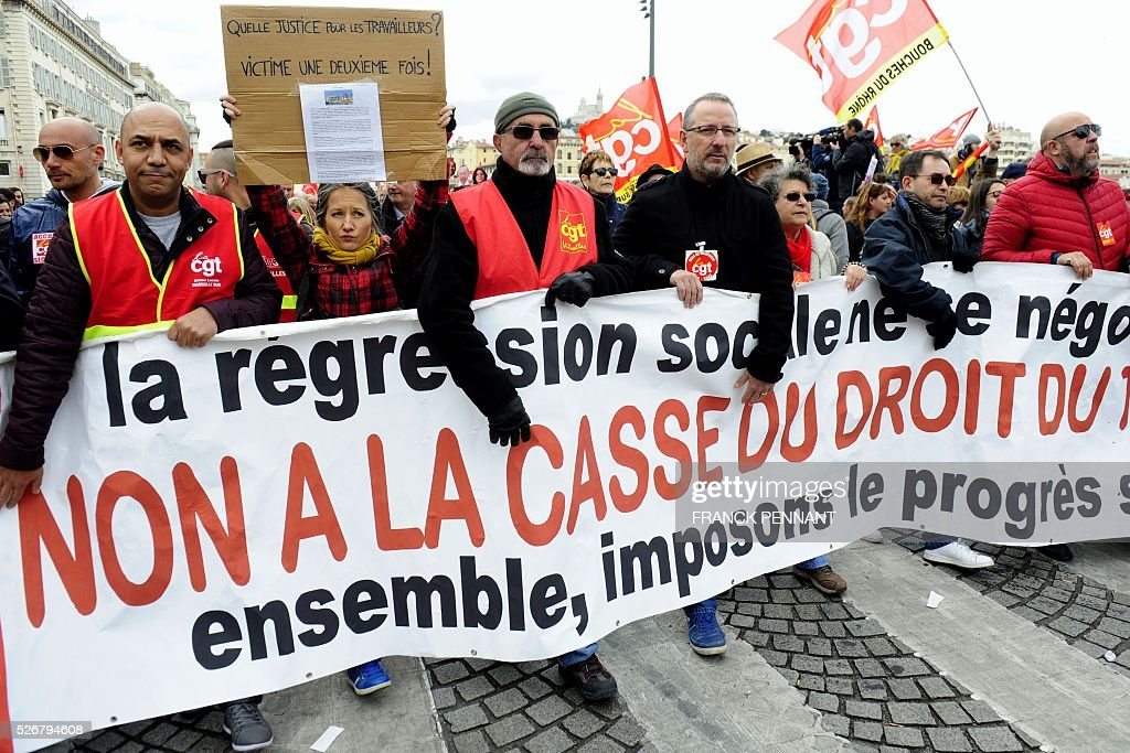 People hold a banner reading 'Social regression is not negotiable, no to the destruction of the labour law, together let's demand social progress' as they demonstrate in the streets of Marseille during the traditional May Day rally on May 1, 2016. / AFP / Franck PENNANT