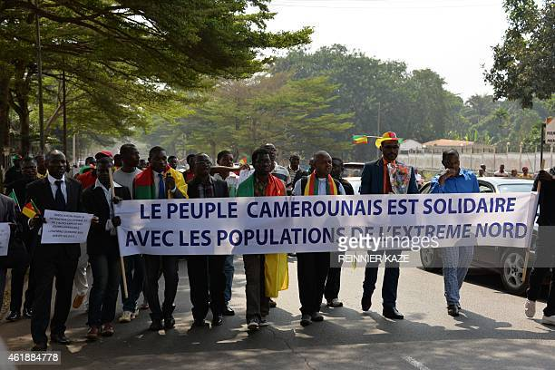 People hold a banner reading 'The Cameroonian people united with the populations of the far north' during a gathering on January 21 2015 in Yaounde...