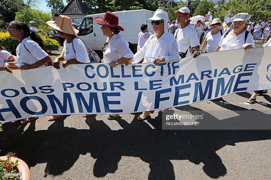 'Every one for the same-sex marriage', the name of the group of associations which support the same-sex marriage, during a demonstration, on December 9, 2012, in Saint-Denis de la Reunion, on the French Indian Ocean island of La Reunion. France's Socialist government adopted on November 7, 2012 a draft law to authorise gay marriage and adoption despite fierce opposition from the Roman Catholic Church and the right-wing opposition.