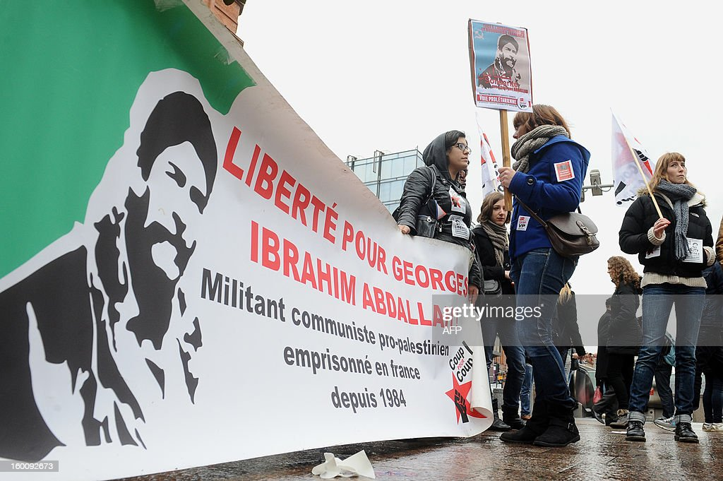 People hold a banner with a portrait of Georges Ibrahim Abdallah, a pro-palestinian militant, and reading 'Freedom for Georges Ibrahim Abdallh' during a protest in Toulouse, southwestern France, on January 26, 2013. French ambassador to Lebanon Patrice Paoli promised on January 15, 2013 to convey to his government concerns aired by the Lebanese authorities over the delayed release of a militant granted parole. A French court granted Georges Ibrahim Abdallah, 61, parole in November on condition he be deported but a judicial source said on Monday the interior ministry had yet to issue the deportation order. The court postponed its decision on his release until January 28. .AFP PHOTO/REMY GABALDA