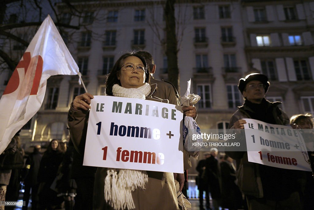 'Marriage is a man + a woman' during a protest organized by fundamentalist Christians group Civitas Institute against same-sex marriage on January 29, 2013 in Paris. France's parliament began today examining draft legislation on same-sex marriage after months of rancorous debate and huge street protests by both supporters and opponents.