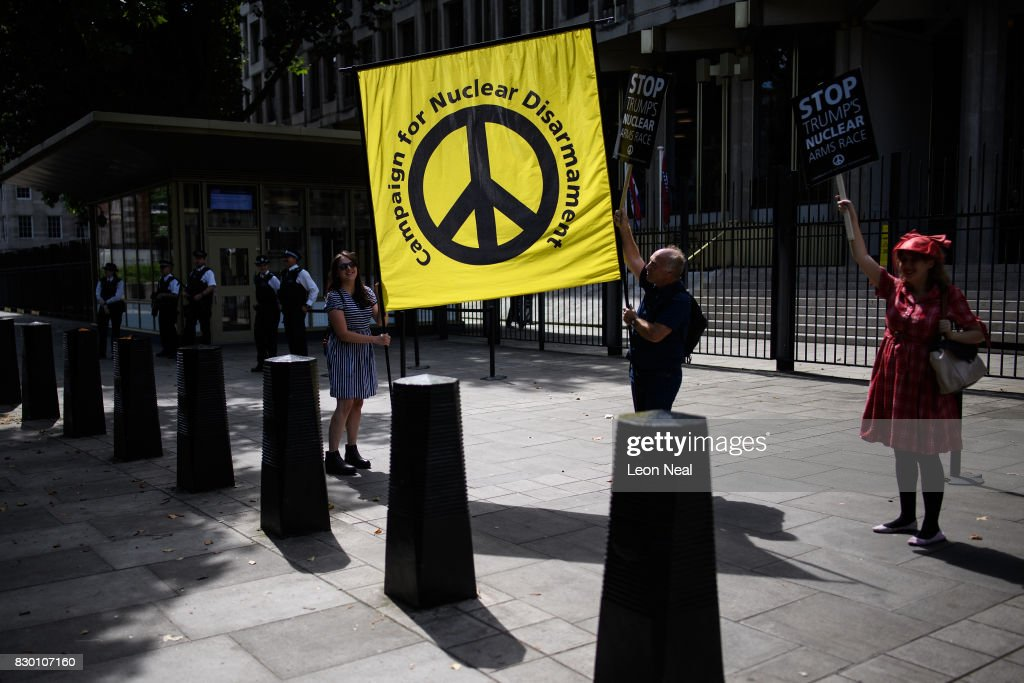People hold a CND (Campaign for Nuclear Disamament) outside the U.S. embassy during a 'Stop the War' protest on August 11, 2017 in London, England. The group called the demonstration to campaign against the growing tensions between the U.S. and North Korea which they believe is being further fanned by Donald Trump's hardline statements.
