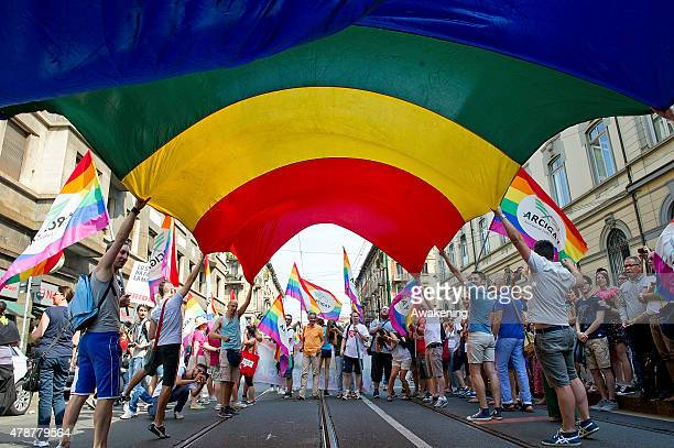 People hold a rainbow flag during the Gay Pride parade on June 27 2015 in Milan Italy Yesterday the United States Supreme Court legalized gay...