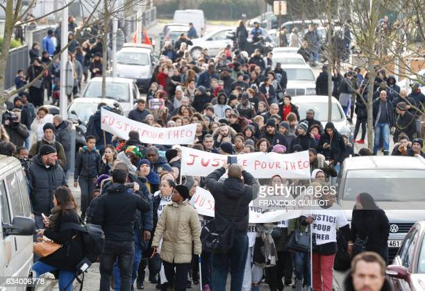 People hold a sign reading 'Justice for Theo' during a protest on February 6 2017 in AulnaysousBois northern Paris a day after a French police...