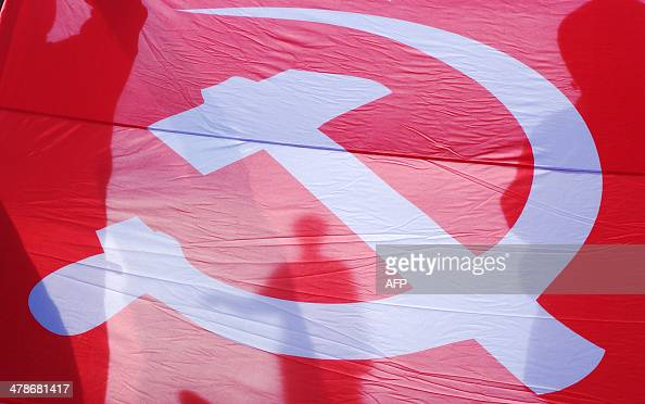 People hold a Soviet flag as they take part in a proRussian rally in the Black Sea Ukrainian city of Odessa on March 14 2014 The United States and...