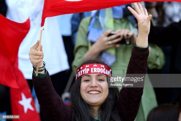 People hold a Turkish flag during a graduation ceremony of ImamHatip Graduates and Members Association at the Recep Tayyip Erdogan stadium in...