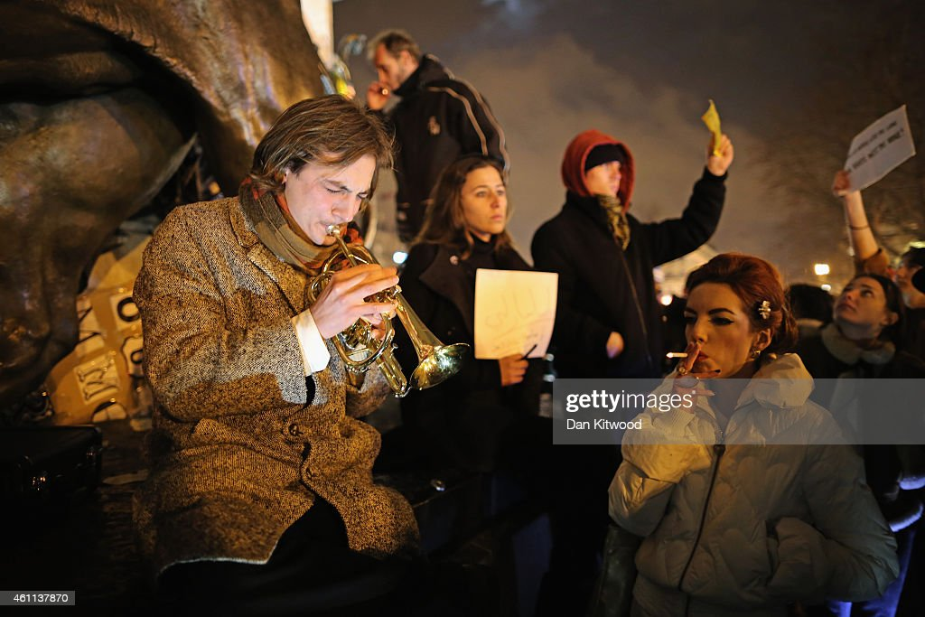 People hold a vigil at the Place de la Republique (Republic Square) for victims of the terrorist attack, on January 7, 2015 in Paris, France. Twelve people were killed, including two police officers, after gunmen opened fire at the offices of the French satirical publication Charlie Hebdo.