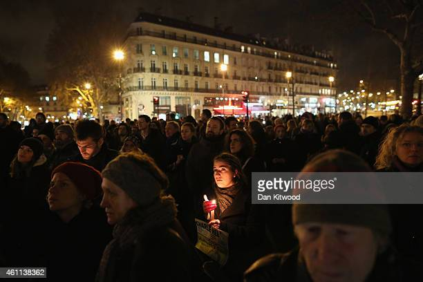 People hold a vigil at the Place de la Republique for victims of the terrorist attack on January 7 2015 in Paris France Twelve people were killed...