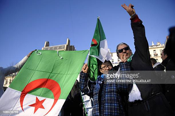 People hold Algerian flags on January 22 2011 in Marseille southern France in support of local prodemocracy demonstrations in Algeria The Algerian...