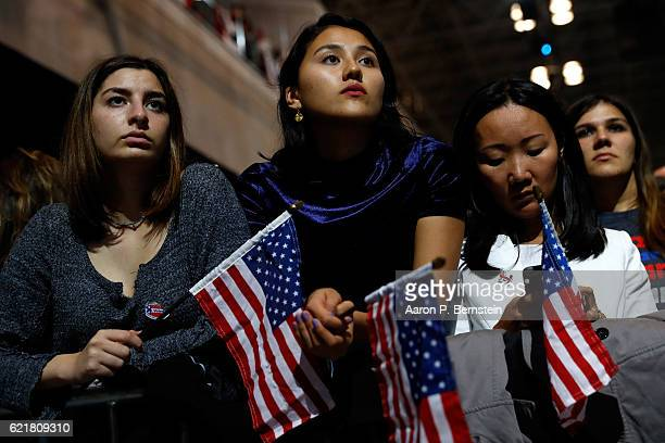 People hold American flags as they watch voting results at Democratic presidential nominee former Secretary of State Hillary Clinton's election night...