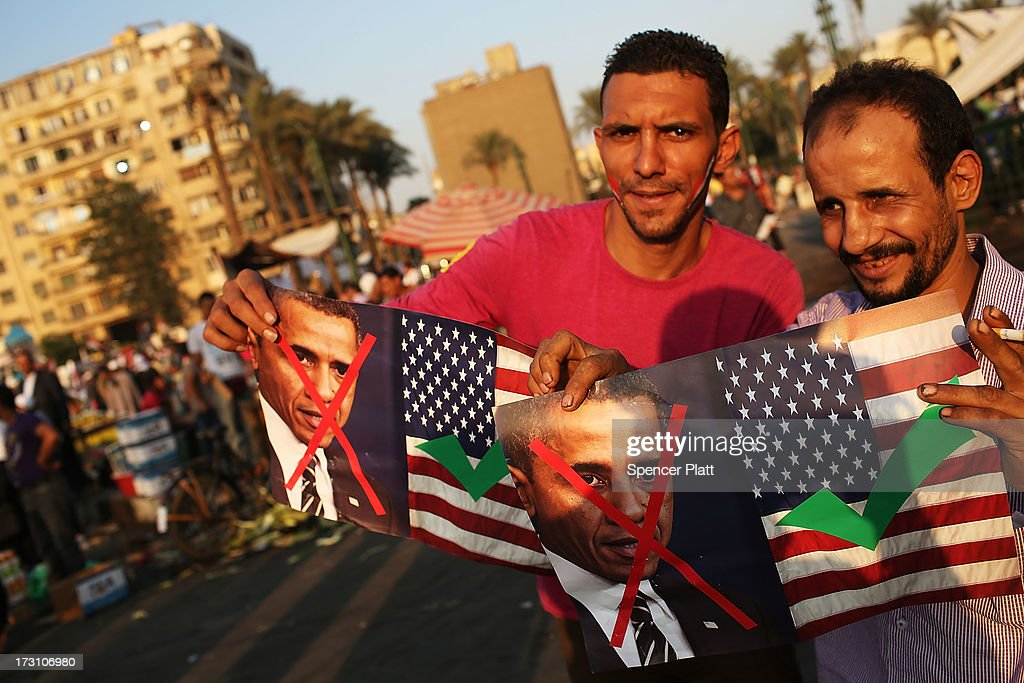 People hold anti President Obama signs at a large rally in Tahrir Square against ousted Egyptian President Mohamed Morsi on July 7 2013 in Cairo...