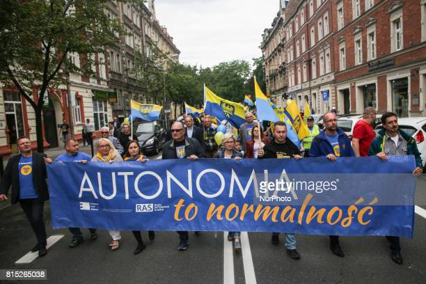 People hold 'Autonomy is normality' banner during march for Silesian autonomy in Katowice Poland on 15 July 2017 The March was organized by Ruch...