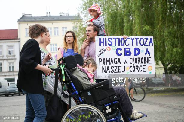 People hold banner 'Histiocytosis Cannabidiol helps to cure our daughter' during demonstration to demand the legalization of marijuana in Krakow...