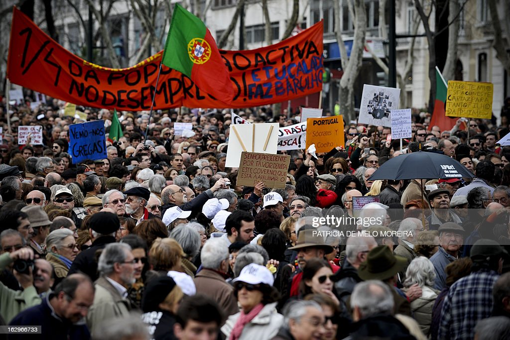 People hold banners and placards as they take part in a demonstration in downtown Lisbon on March 2, 2013. Several thousands of people demonstrated today in the Portuguese capital to protest against government austerity measures.